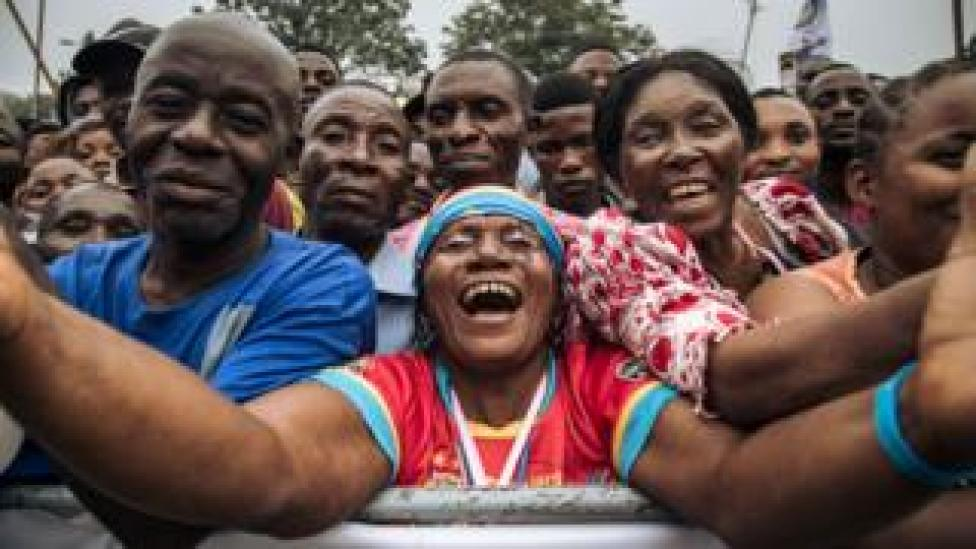 A woman reacts as thousands of people gathered to attend the rally of the leader of the Democratic Republic of Congo's political party Movement for the Liberation of the Congo (MLC) Jean-Pierre Bemba as he returns to the DR Congo on June 23, 2019, in Kinshasa. - Former Vice President Bemba spent ten years in the International Criminal Court (ICC) prison for crimes committed by his troops in Central African Republic. He was then cleared and released on appeal.