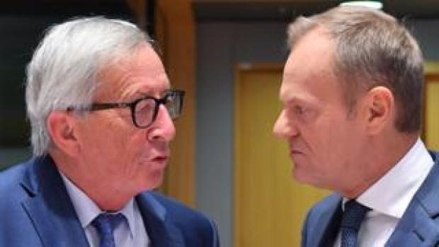 EU's J-C Juncker (L) and Donald Tusk