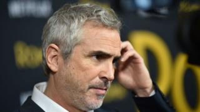 """Mexican director Alfonso Cuarn arrives for the Los Angeles premiere of """"Roma"""" at the Egyptian theatre in Hollywood on 10 December, 2018."""