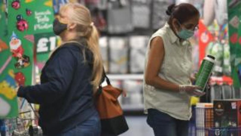 Shoppers wearing masks