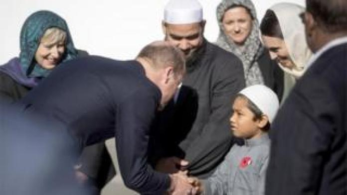 The Duke of Cambridge greets a young member of the Muslim community