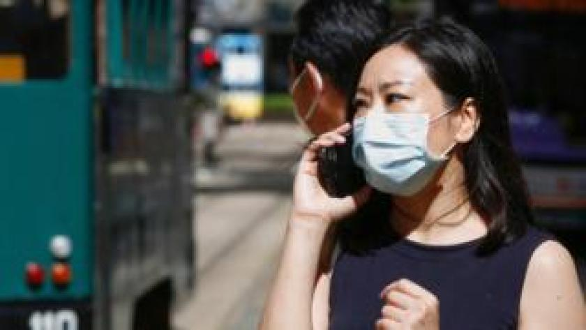 A woman wears a surgical mask following the coronavirus disease (COVID-19) outbreak, in Hong Kong, China July 17, 2020