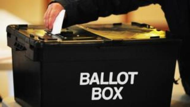 A vote being cast in a ballot box