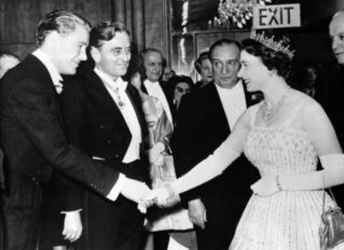 The Queen greeting someone at the Lawrence of Arabia film premiere in Leicester Square in London in 1962