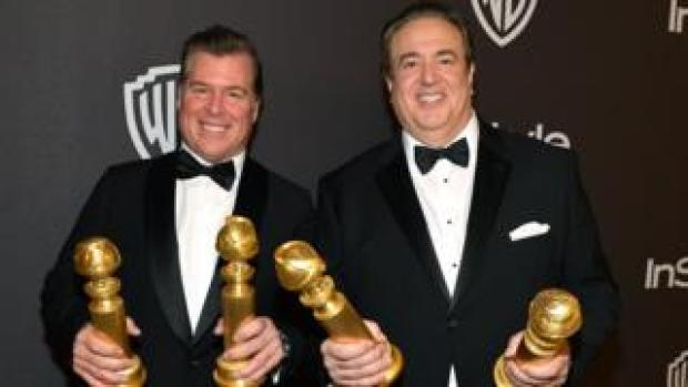 Brian Currie (left) and Nick Vallelonga with their Golden Globes