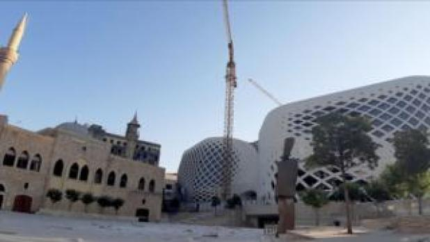 There is a new Beirut commercial complex designed by the late British-Iraqi architect Zaha Hadid.  To the left is the Majidiyah Mosque, the capital of Lebanon.  5 August 2020