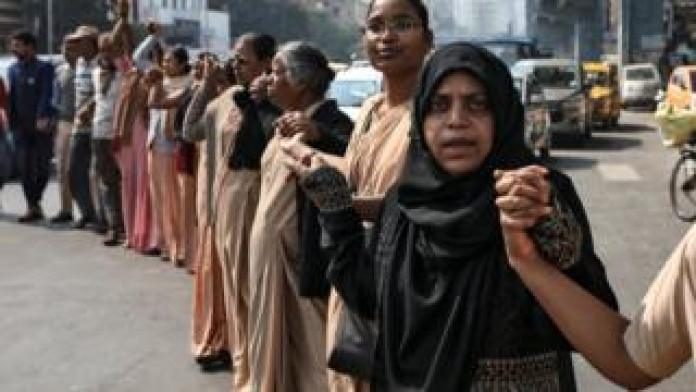 Demonstrators form a human chain after Republic Day celebrations to protest against a new citizenship law in Kolkata, India, 26 January 2020.
