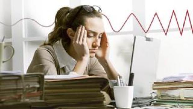 A female worker looking stressed
