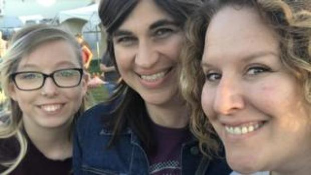 Three women smiling for a photo together