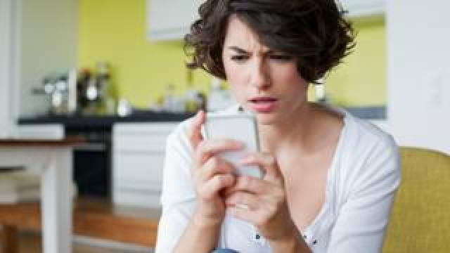 Woman irritated by her phone