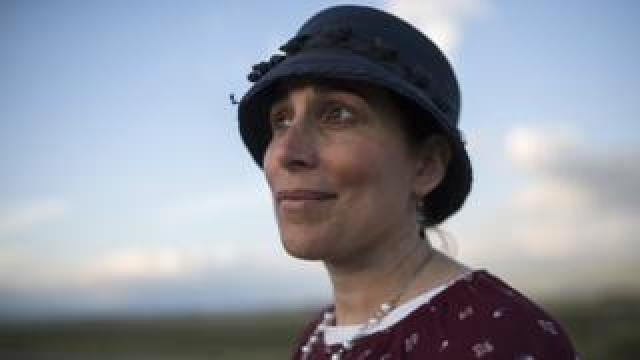 Shani Taragin, 45, a women's health and Jewish law teacher in a wheat field at the Hula Valley in the Upper Galilee in northern Israel during the Passover holiday. (photo by Heidi Levine for BBC)