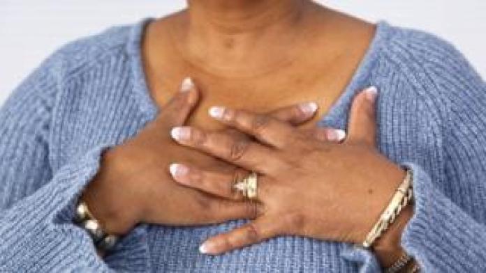 Woman clutching heart