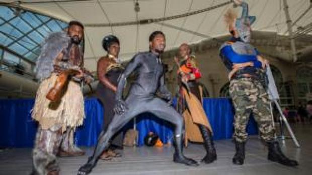 Fans dressed as characters from Marvel's Black Panther movie attend Comic-Con International on July 20, 2018 in San Diego, California.