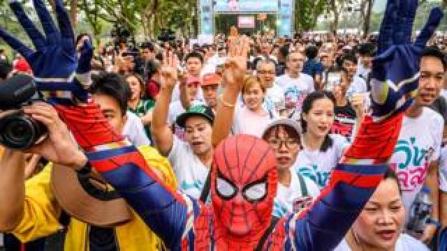 "A man dressed as Spider-Man takes part in a ""run against dictatorship"" in Bangkok"