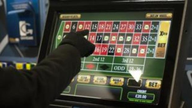 A gambler playing on a machine