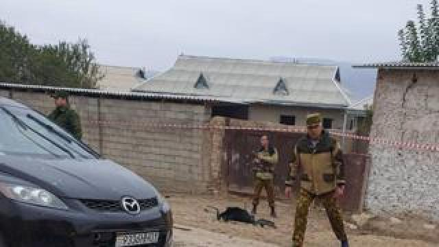 Security officials cordon off the site of the attack in Tajikistan