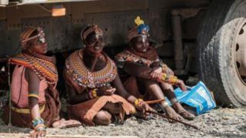 Women of the Turkana tribe rest in the shade of a truck during the 11th Marsabit Lake Turkana Culture Festival in Loiyangalani near Lake Turkana, northern Kenya, in a photo released on June 29, 2018. The annual 3-day festival featurs the cultural traditions of 14 ethnic tribes in Marsabit county to promote tourism and build better relationship between tribes