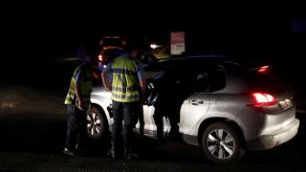 French police stop a car at a roadblock after the cafe crash, 14 August