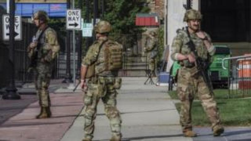 Wisconsin National Guard stand outside the Kenosha County courthouse before the arrival of US President Donald J. Trump in Kenosha, Wisconsin, USA, 01 September 2020