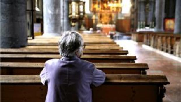 Woman in a church on her own