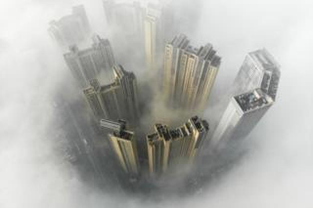 Aerial view of buildings surrounded by heavy fog