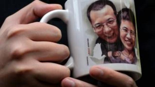 a mug with the couple's faces on