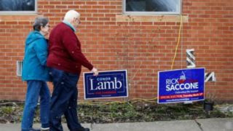 A couple arrive at a polling place in Carnegie, Pennsylvania.