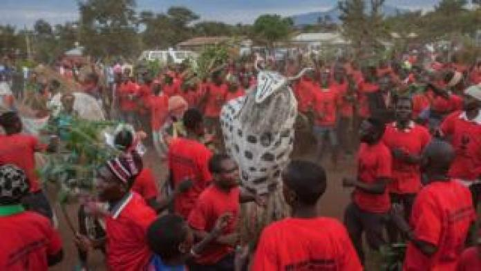 """A large group of people dancing with a """"beast spirit"""" - Sunday 12 May"""