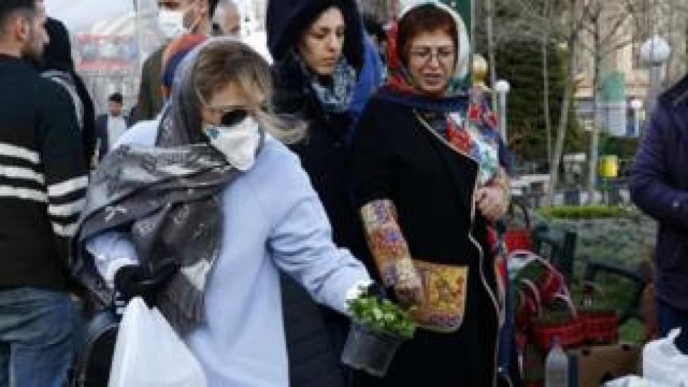 Iranian women shop for Nowruz items at a market in Tehran (19 March 2020)