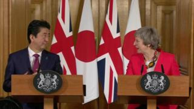 UK Prime Minister Theresa May and Japan's Prime Minister Shinzo Abe give a joint press conference