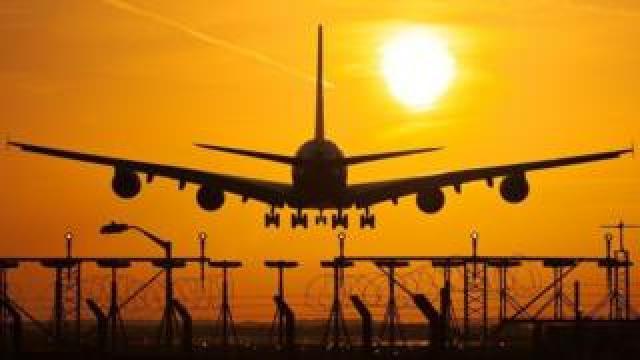 airplane-landing-at-sunset
