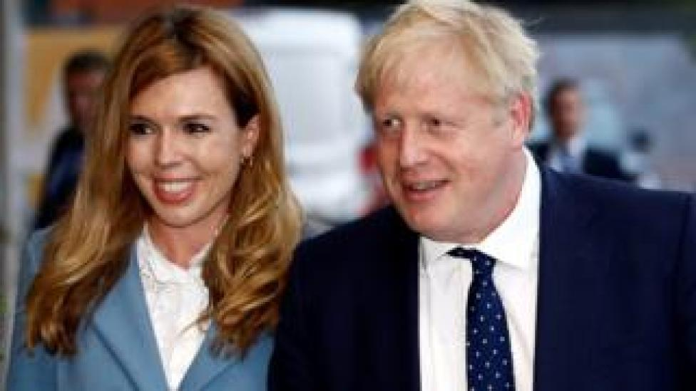 Prime Minister Boris Johnson and his girlfriend Carrie Symonds arrive at a hotel ahead of the Conservative Party annual conference in Manchester, Britain,