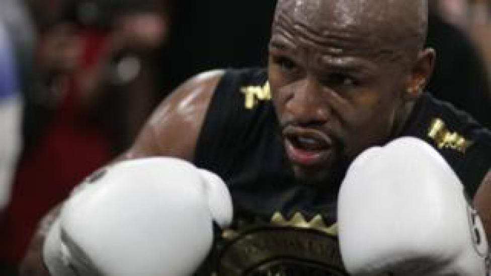 In this file photo taken on August 10, 2017 Boxer Floyd Mayweather Jr. goes through moves during a media workout at the Mayweather Boxing Club in Las Vegas, Nevada