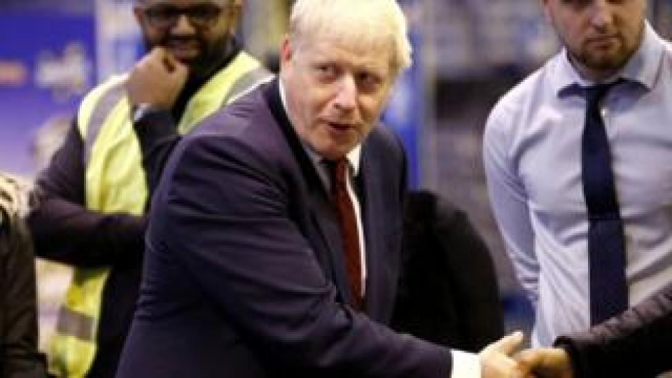 Boris Johnson visiting a business in Manchester