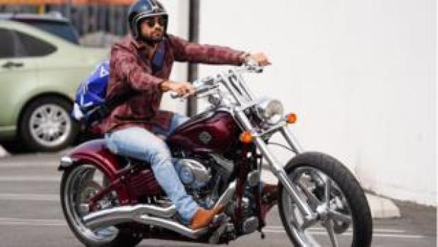 Actor Jesse Metcalfe riding a Harley-Davidson