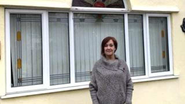 Marianne Phillips outside her home