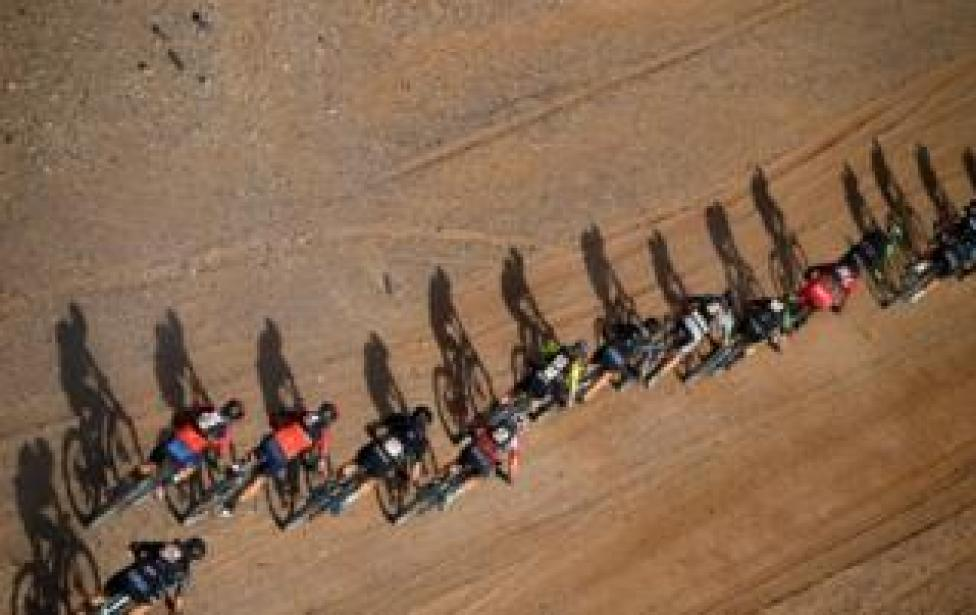 Competitors ride their bikes during Stage 4 of the 14th edition of Titan Desert 2019 mountain biking race between Merzouga and Mssici, in Morocco, on May 1, 2019