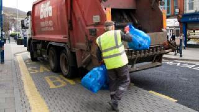 Waste being thrown into Biffa truck