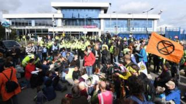 Extinction Rebellion protesters block the entrance London City Airport in London on 10 October
