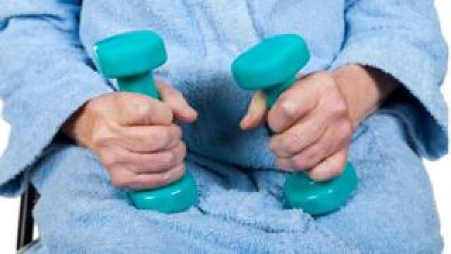 Using dumbbell weights to exercise muscles