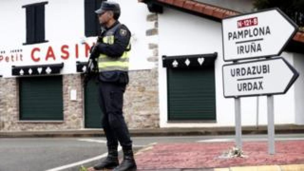 Spanish policeman stands guard at the Spanish side of the border crossing between Spain and France, close to the village of Dantxarinea, Navarra
