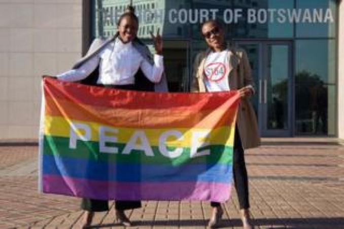 Two activists pose with a rainbow flag as they celebrate outside Botswana High Court in Gaborone on 11 June.
