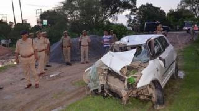 Police next to the crashed car in Uttar Pradesh (28 July 2019)