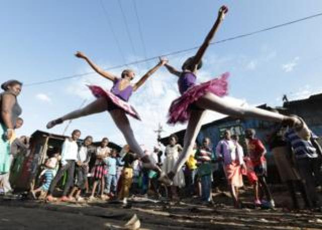 Young ballerinas from different schools perform a dance during a ballet street performance to showcase their skills in Kibera slum, Nairobi, Kenya - Friday 30 November 2018.
