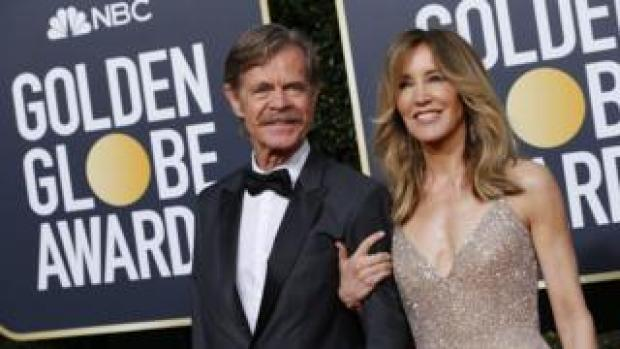 Actors Felicity Huffman and William H Macy at the Golden Globe Awards in January 2019