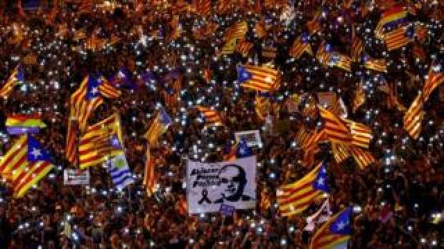 Protesters wave Catalan flags in Madrid, Spain. Photo: 16 March 2019