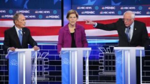 Mike Bloomberg, left, Elizabeth Warren, middle, and Bernie Sanders, right, on the debate stage.