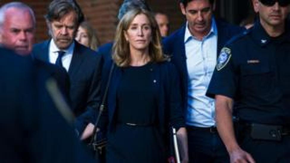 sport Huffman leaves her sentencing hearing in September (FILE)