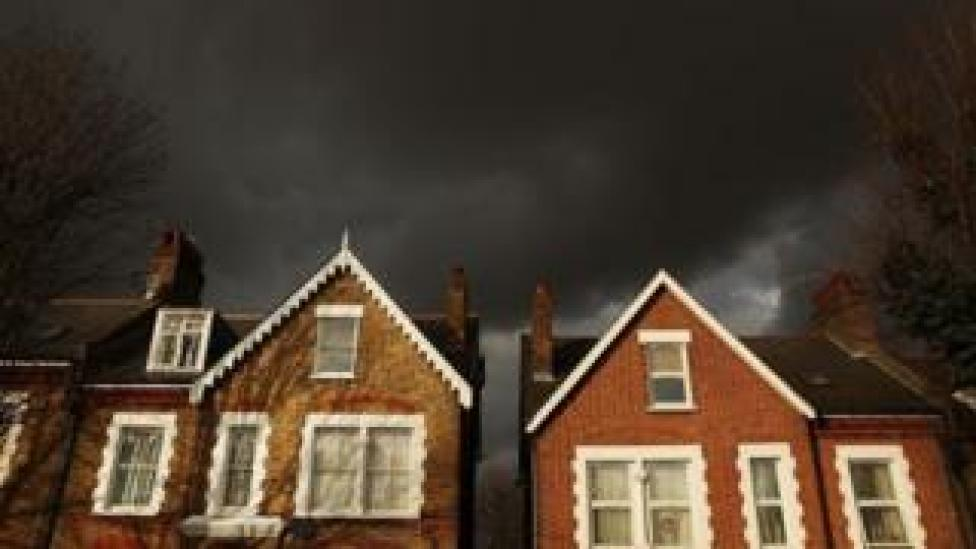Dark clouds over houses