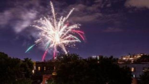 Illegal fireworks illuminate the sky over the Bedford-Stuyvesant neighbourhood of the Brooklyn borough of New York City on 19 June
